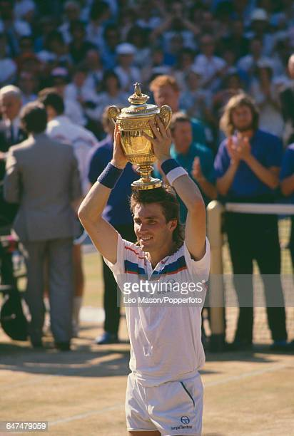 Australian tennis player Pat Cash holds up the Gentlemen's Singles Challenge Cup Trophy after defeating Ivan Lendl in the final of the Men's Singles...
