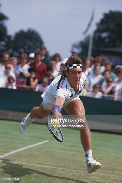 Australian tennis player Pat Cash pictured in action competing to progress to win the final of the Men's Singles tournament at the Wimbledon Lawn...