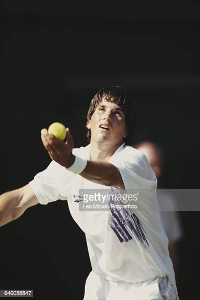 Australian tennis player Pat Rafter pictured in action competing to reach the second round in the Men's Singles tournament at the Wimbledon Lawn...