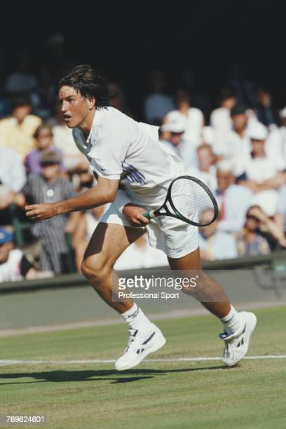 Australian tennis player Patrick Rafter pictured competing to reach the second round of the Men's Singles tournament at the Wimbledon Lawn Tennis...