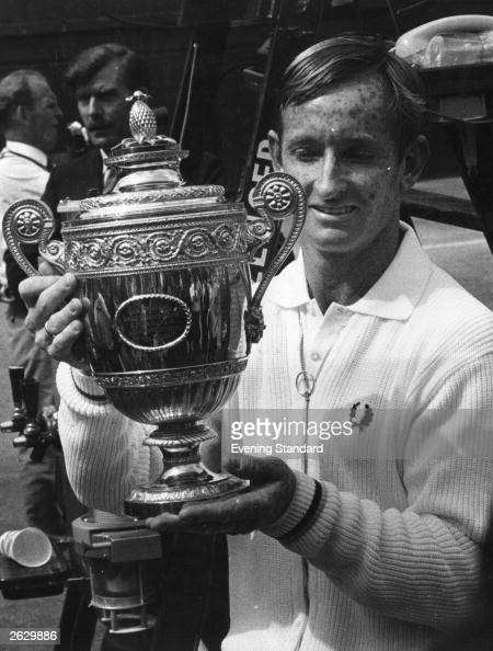 Australian tennis player Rod Laver holds up the trophy after beating Tony Roche to win the men's singles title at Wimbledon Original Publication...