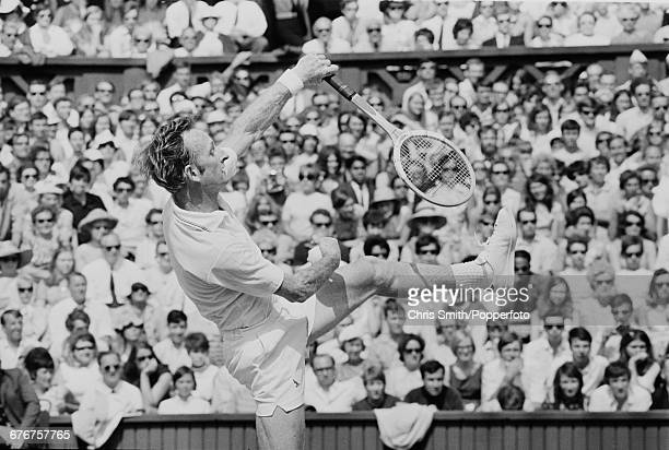 Australian tennis player Rod Laver pictured in action competing to win the final of the Men's Singles tournament against fellow Australian John...