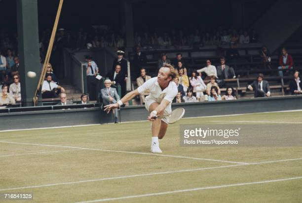 Australian tennis player Rod Laver pictured in action during competition to reach the quarterfinals of the Men's Singles competition at the Wimbledon...
