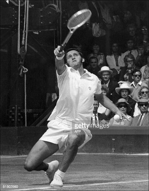 Australian tennis player Roy Emerson stretches to reach a ball 01 July 1970 during the Wimbledon championships Emerson won twice the men's singles...