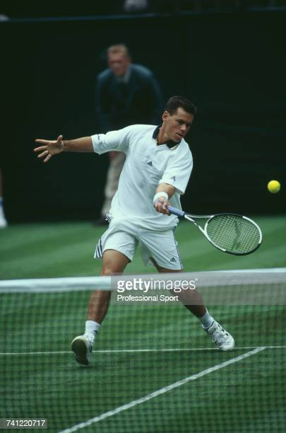 Australian tennis player Scott Draper pictured in action against American tennis player Pete Sampras in the first round of the Men's Singles tennis...