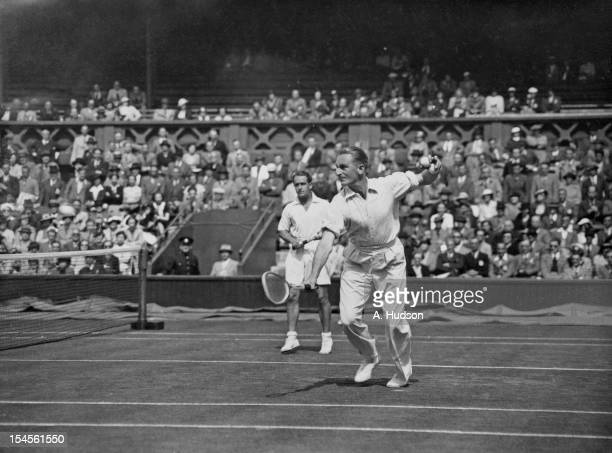 Australian tennis players Jack Crawford and Adrian Quist in action during their Davis Cup Challenge Round doubles match against Raymond Tuckey and...