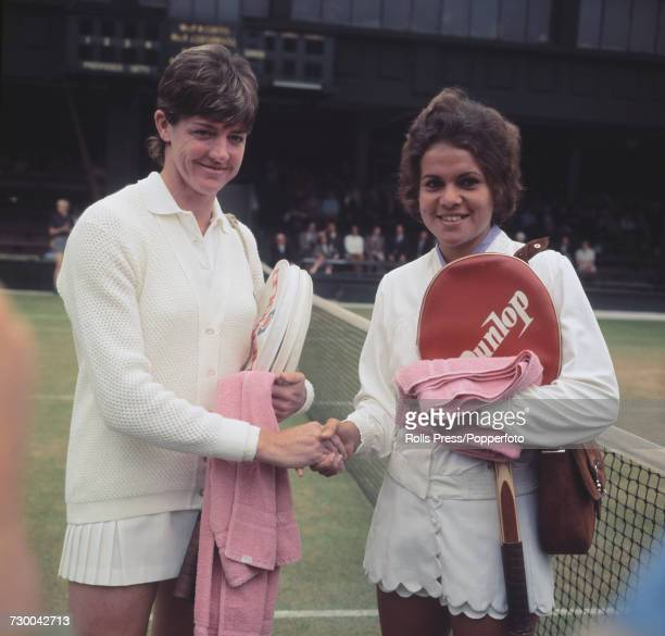 Australian tennis players Margaret Court and Evonne Goolagong pictured shaking hands on court the day before their final match at the 1971 Wimbledon...