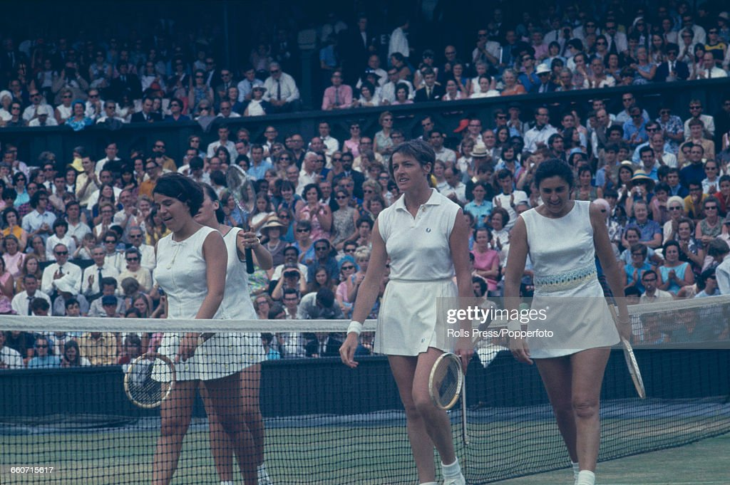 Australian tennis players Margaret Court and Judy Tegart walk off the court with American tennis players Patti Hogan and Peggy Michel during the...