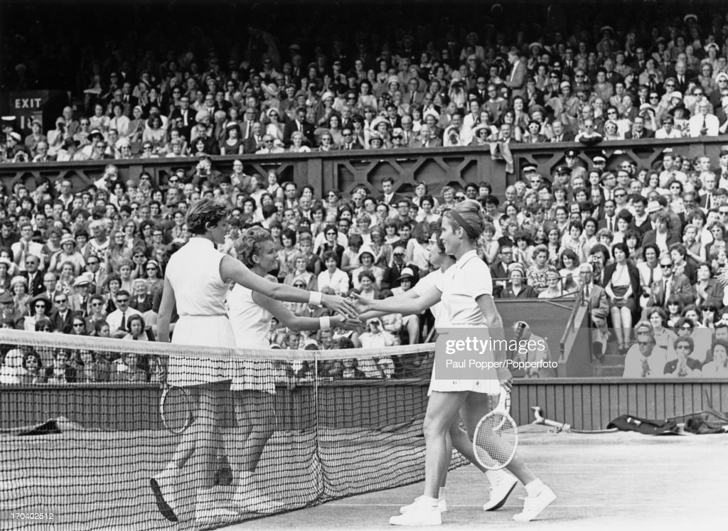 Australian tennis players <a gi-track='captionPersonalityLinkClicked' href=/galleries/search?phrase=Margaret+Court&family=editorial&specificpeople=226911 ng-click='$event.stopPropagation()'>Margaret Court</a> (left, foreground) and Lesley Turner Bowrey shake hands over the net with their American opponents Karen Hantze Susman (right, foreground) and <a gi-track='captionPersonalityLinkClicked' href=/galleries/search?phrase=Billie+Jean+King&family=editorial&specificpeople=93147 ng-click='$event.stopPropagation()'>Billie Jean King</a> after the Australians won the Ladies' Doubles Final, 7-5, 6-2, at Wimbledon, London, 4th July 1964.