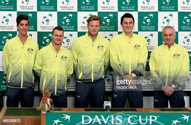 Australian tennis players Thanasi Kokkinakis Lleyton Hewitt Samuel Groth Bernard Tomic and team captain Wally Masur pose during the official draw...