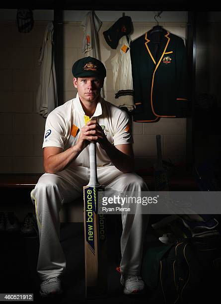 Australian Test captain Steve Smith poses with his captain's blazer during a portrait session at The Gabba on December 16 2014 in Brisbane Australia...