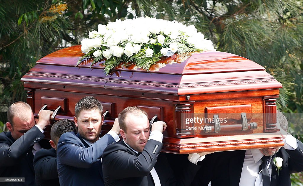 Australian Test Cricket Captain Michael Clarke and Jason Hughes carry the coffin during the Funeral Service for Phillip Hughes on December 3 2014 in...