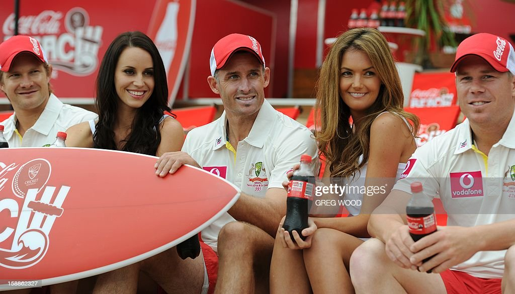 Australian Test cricketer Michael Hussey (C) with teammates Shane Watson (L) and David Warner (R) and models Lauren Vickers (2nd L) and Amber Bernauer (2nd R), enjoy the world's first pop-up beach at the cricket launch at the Sydney Cricket Ground on the eve of the third cricket Test between Sri Lanka and Australia in Sydney on January 2, 2013. IMAGE STRICTLY RESTRICTED TO EDITORIAL USE - STRICTLY NO COMMERCIAL USE AFP PHOTO / Greg WOOD