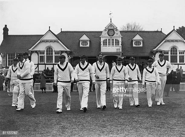 Australian test cricketer William Joseph 'Tiger' O'Reilly and the rest of the team walk out for a match against Worcester 1938