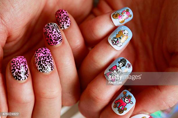 Australian Thea Mai Baumann poses a picture with her nails at Nail IT Studio on May 26 2015 in Shanghai China