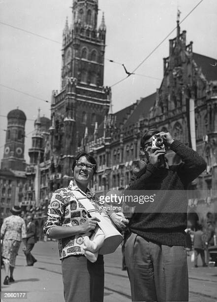 Australian tourists taking holiday snaps in front of the town hall in Munich