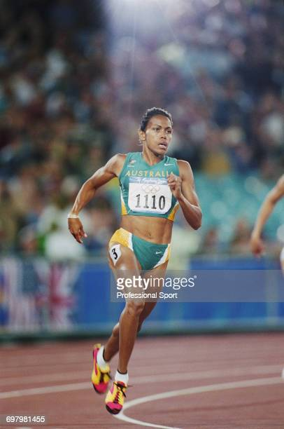 Australian track athlete Cathy Freeman competes in the heats prior to finishing in first place to win the gold medal in the final of the Women's 400...