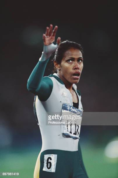 Australian track athlete Cathy Freeman pictured waving to the crowd after finishing in first place to win the gold medal in the final of the Women's...