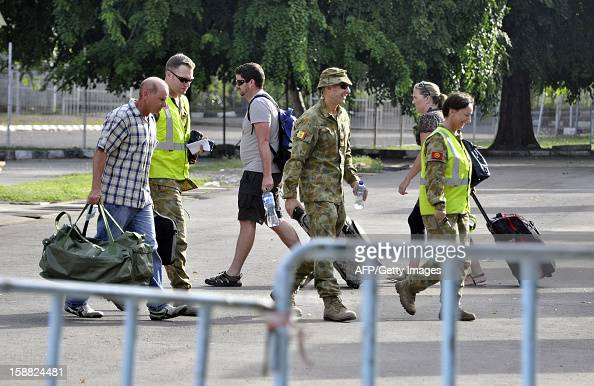 Australian troops accompany UN officials leaving East Timor through Dili's airport on December 31 2012 ahead of the closure of the UN's peacekeeping...