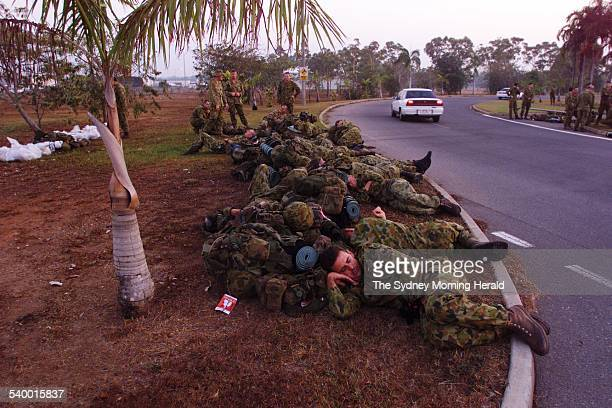 Australian troops sleep at Darwin Domestic Airport after arriving from Townsville The soldiers are bound for RAAF Base Darwin before being deployed...