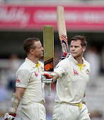Australian unbeaten batsmen Chris Rogers and Steven Smith of Australia leave the field at the end of day one of the 2nd Investec Ashes Test match...