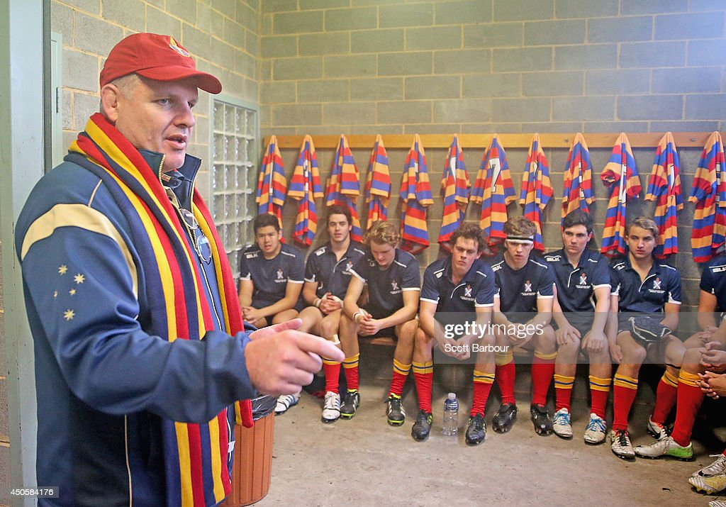 Australian Wallabies coach Ewen McKenzie addresses Scotch College players in their changing rooms before the match as he attends St Kevin's College...