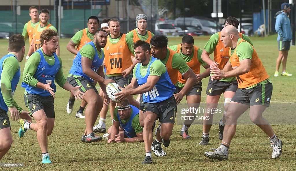 Australian Wallabies players play during a training session in Sydney on August 5 2016 Coach Michael Cheika named five foreignbased stars and four...