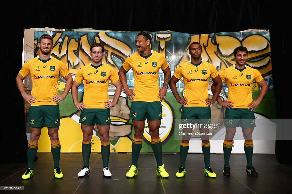 Australian Wallabies <a gi-track='captionPersonalityLinkClicked' href=/galleries/search?phrase=Rob+Horne&family=editorial&specificpeople=5127758 ng-click='$event.stopPropagation()'>Rob Horne</a>, <a gi-track='captionPersonalityLinkClicked' href=/galleries/search?phrase=Bernard+Foley&family=editorial&specificpeople=6563906 ng-click='$event.stopPropagation()'>Bernard Foley</a>, <a gi-track='captionPersonalityLinkClicked' href=/galleries/search?phrase=Israel+Folau&family=editorial&specificpeople=4194699 ng-click='$event.stopPropagation()'>Israel Folau</a>, <a gi-track='captionPersonalityLinkClicked' href=/galleries/search?phrase=Kurtley+Beale&family=editorial&specificpeople=3020818 ng-click='$event.stopPropagation()'>Kurtley Beale</a> and <a gi-track='captionPersonalityLinkClicked' href=/galleries/search?phrase=Nick+Phipps+-+Rugbyspelare&family=editorial&specificpeople=10985377 ng-click='$event.stopPropagation()'>Nick Phipps</a> pose in the new Asics Wallabies jersey during the Australian Wallabies jersey launch at All Sorts Sports Factory on May 4, 2016 in Sydney, Australia.