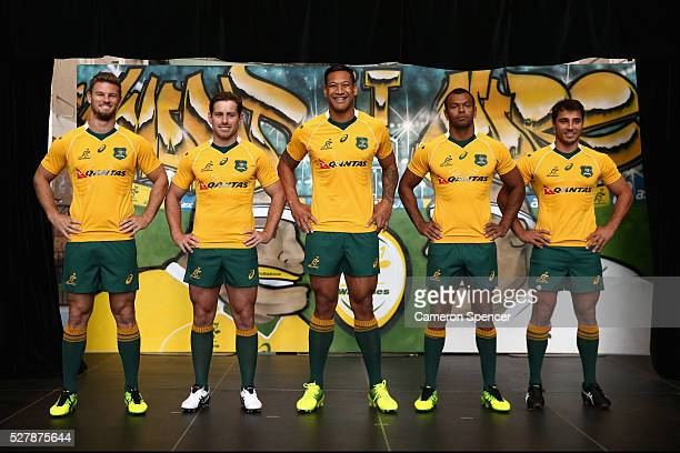 Australian Wallabies Rob Horne Bernard Foley Israel Folau Kurtley Beale and Nick Phipps pose in the new Asics Wallabies jersey during the Australian...