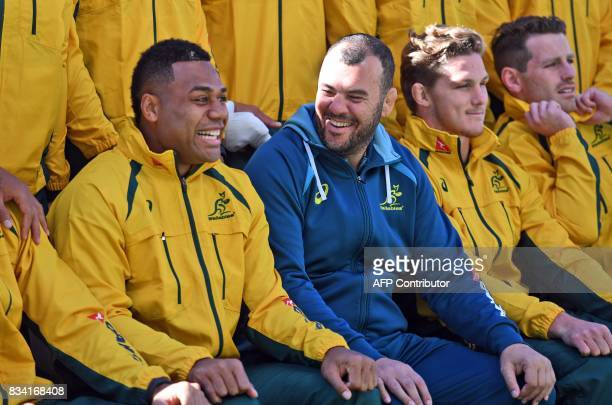 Australian Wallabies rugby player Samu Kerevi share a lighter moment with coach Micheal Cheika as teammates Michael Hooper and Michael Hooper look on...
