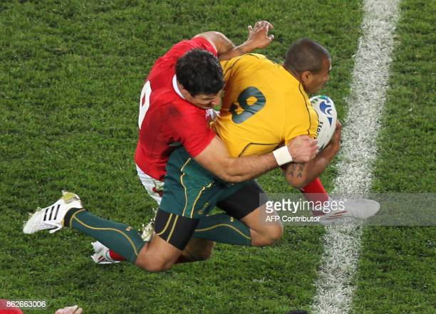 Australian Wallabies scrumhalf Will Genia is tackled by Wales' scrumhalf Michael Phillips during the 2011 Rugby World Cup bronze final match Wales vs...