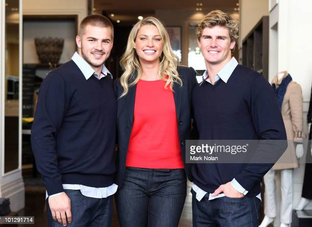 Australian Wallabies stars Drew Mitchell and Berrick Barnes pose with Australian model Kristy Hinze during a media event at Sportscraft in Double Bay...