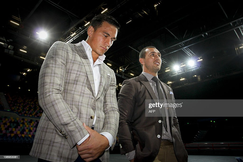 Australian Wallaby fly-half Quade Cooper (R) and former New Zealand All Black Sonny Bill Williams (L) attend a press conference in Brisbane on November 26, 2012. Cooper on November 26 said he was putting his rugby union career on hold as he prepares to make his debut in the boxing ring early next year. AFP PHOTO / Patrick HAMILTON