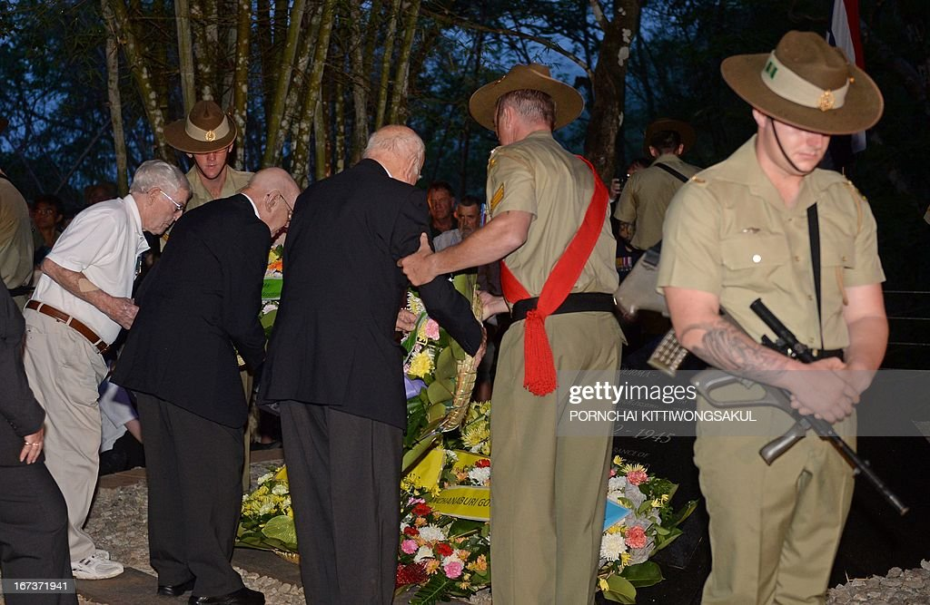 Australian war veterans lay flowers at a memorial as they attend a ceremony to mark Anzac Day at Hellfire Pass in Kanchanaburi province, western Thailand on April 25, 2013. Hundreds of Australian and New Zealand war veterans and relatives of fallen soldiers marked Anzac Day with a dawn vigil along Thailand's infamous Death Railway, where over 110,000 people perished during WWII.