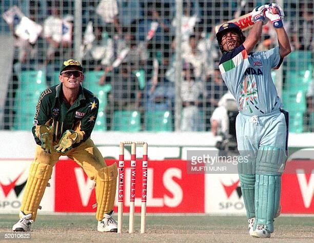 Australian wicketkeeper Adam Gilchrist watches as Indian batsman Sachin Tendulkar lofts a six during his innings of 141 off 127 balls in the mini...
