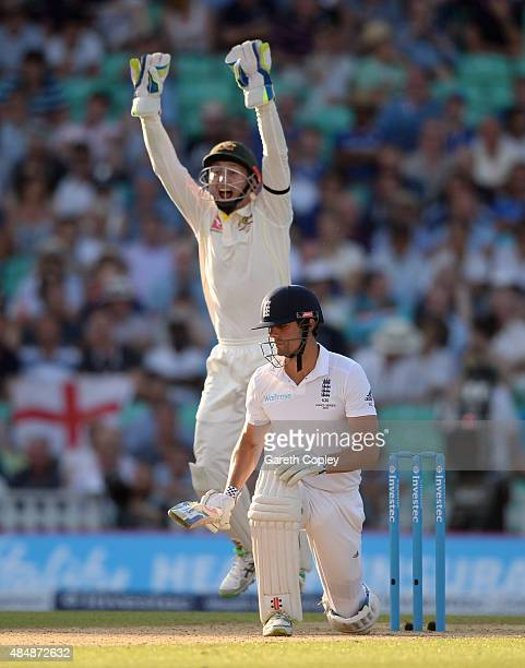 Australian wicketkeeper Peter Nevill celebrates the wicket of England captain Alastair Cook during day three of the 5th Investec Ashes Test match...