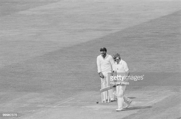 Australian wicketkeeper Rod Marsh shouts in triumph as England batsman Graham Gooch is bowled out for 54 by Alan Border in the Prudential Trophy...