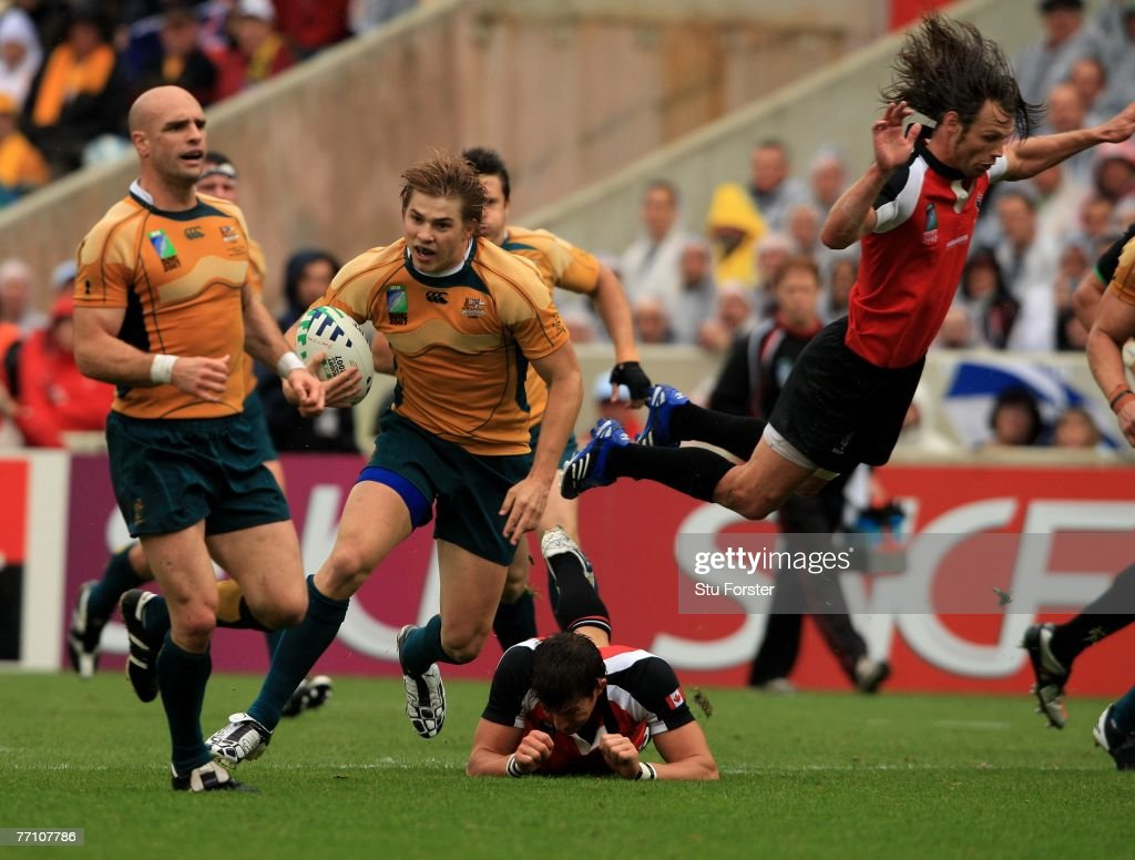 Australian wing Drew Mitchell makes a break during the IRB Rugby World Cup Pool B match between Australia and Canada at the Stade ChabanDelmas on...