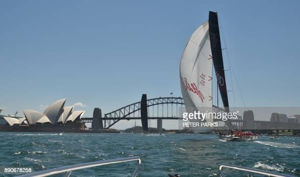 Australian yacht Black Jack beats Australian supermaxi yacht Wild Oats XI to the finish line in the SOLAS Big Boat Challenge on Sydney Harbour on...