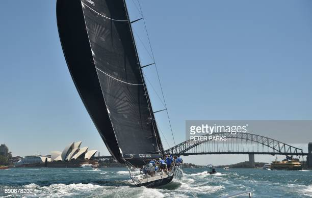 Australian yacht Black Jack heads first to the finish line in the SOLAS Big Boat Challenge on Sydney Harbour on December 12 2017 / AFP PHOTO / PETER...