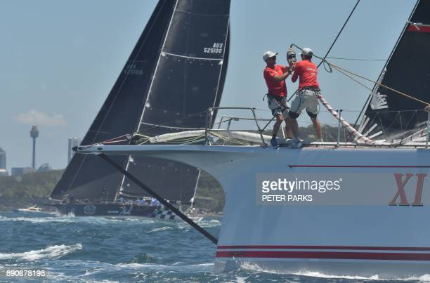 Australian yacht Black Jack leads Australian supermaxi yacht Wild Oats XI to the finish line in the SOLAS Big Boat Challenge on Sydney Harbour on...