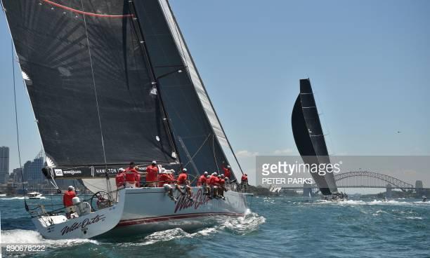 Australian yacht Black Jack leads Australian supermaxi yacht Wild Oats XI during the SOLAS Big Boat Challenge on Sydney Harbour on December 12 2017 /...