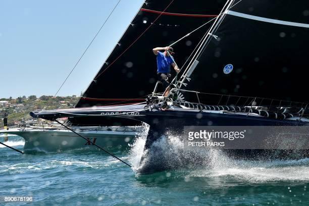 Australian yacht Black Jack races against Australian supermaxi yacht Wild Oats XI during the SOLAS Big Boat Challenge on Sydney Harbour on December...