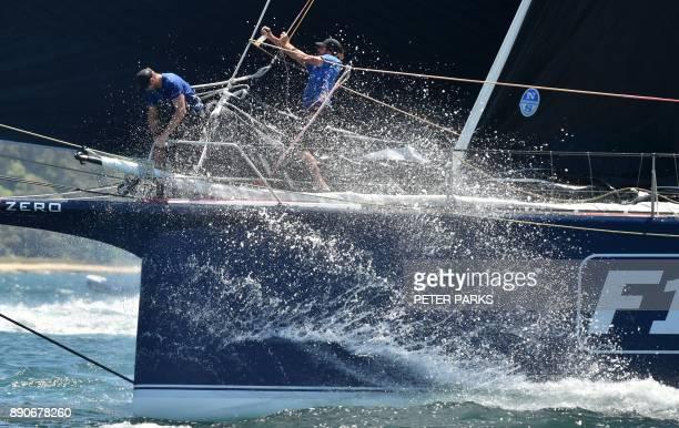 Australian yacht Black Jack races in the SOLAS Big Boat Challenge on Sydney Harbour on December 12 2017 / AFP PHOTO / PETER PARKS / IMAGE RESTRICTED...