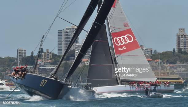 Australian yacht Wild Oats X and Hong Kong yacht Beau Geste race in the SOLAS Big Boat Challenge on Sydney Harbour on December 12 2017 / AFP PHOTO /...