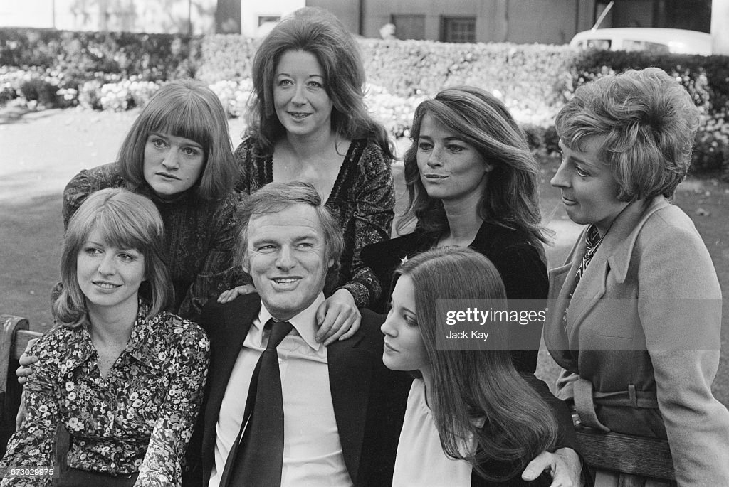 Australian-born actor Keith Michell (1926 - 2015), who is playing the part of King Henry VIII in the film 'Henry VIII and His Six Wives', with the actresses who play his wives; (left to right, back row) Jenny Bos (Ann of Cleves), Frances Cuka (Katherine of Aragon), Charlotte Rampling (Ann Boleyn), Barbara Leigh-Hunt (Catherine Parr); (front row) Jane Asher (Jane Seymour), Michell and Lynne Frederick (Catherine Howard), UK, 5th October 1971.