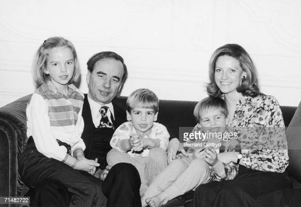 Australianborn American media billionaire Rupert Murdoch sits with his second wife and their three children Elisabeth Lachlan and James on a couch...