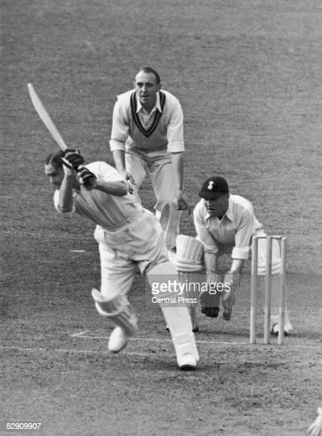 Australianborn British cricketer George Oswald Browning Allen of Middlesex drives a ball from F R Brown of Surrey during a match at the Oval 1939