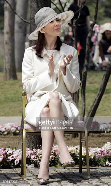 Australianborn Danish Crown Princess Mary claps while attending the welcome ceremony at the Hans Christian Andersen Park in Funabashi city Chiba...