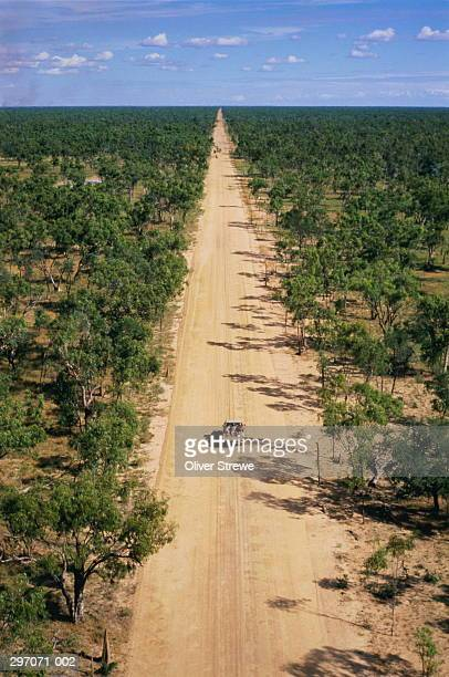 Australia,Northen Territory,view of straight road in remote bush land